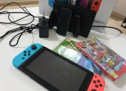Photo de l'annonce: Nintendo switch Kit complet + 2 jeux